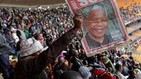 Singing crowds gather for Mandela memorial