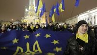 Ukraine leader offers olive branch in protests