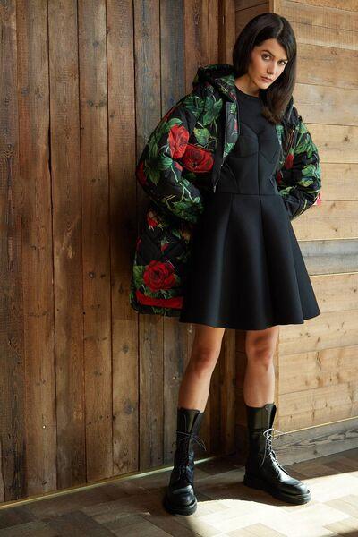 Pink print puffer jacket, € 2,250, black corset dress, € 1,550, both Dolce & Gabbana, black combat boots, € 975, Magda Butrym