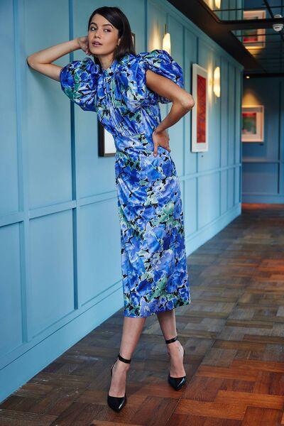 Floral print midi dress, € 340, Rotate, black pumps, € 615, Magda Butrym
