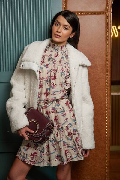 Cream aviator jacket, € 470, Viktoria & Les bois;  floral print dress, € 400, Magali Pascal, shoulder bag, € 395, See by Chloe