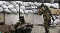 Gunfire and explosions heard in Ukraine city