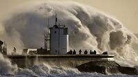 Storm batters UK as miles of British coastline endures floods