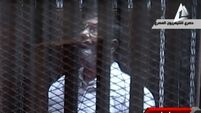 Former Egyptian president Morsi goes on trial - enclosed in cage