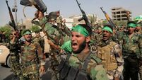 Iraq militiamen in show of force
