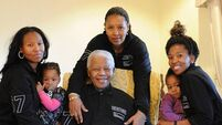 Mandela includes staff and schools in his will