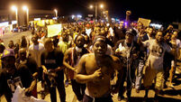 Ferguson unrest continues as residents asked to stay home