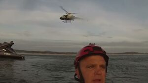 Dramatic paraglider crash and rescue captured on helmet-cam
