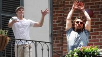 Brad Pitt tosses Matthew McConaughey a beer over New Orleans street
