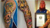 Simpsons superfan sets world record with Homer tattoos