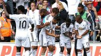 Swansea maintain momentum with defeat of Burnley