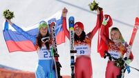 Gisin and Maze share downhill gold