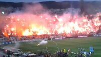 Scary flares disrupt game in Greece