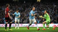 City keep pressure on Liverpool with home win