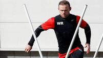 Injury worry Rooney able to train