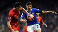 Liverpool advance with brace over Oldham