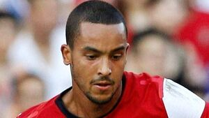 Arsenal won't get carried away by wins, Walcott claims