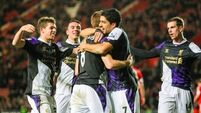 Suarez inspires Reds to victory over Southampton