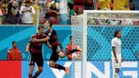 Muller on target again as Germany and USA qualify