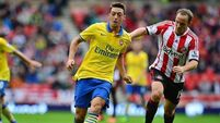 Ozil on the bench for Gunners; Torres starts for Blues in London derby