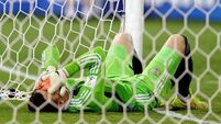 Russia salvage draw after goalkeeping howler