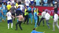 VIDEO: Russian player Granat in broken-jaw fear after pitch invasion