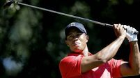 Woods ties course record at home tournament