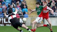 Freeman brace sees Mayo into semis
