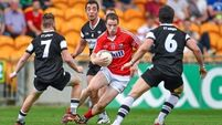 Cork adopt new style to advance to quarter-final