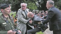 Protester wrestled by ambassador apologises to avoid criminal record