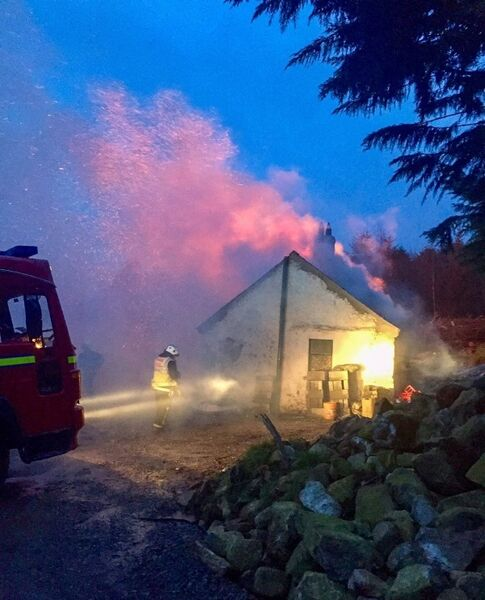 Firefighters battling the fire at Alisha McKevitt's house in Omeath, Co Louth. Picture: Ciara Wilkinson