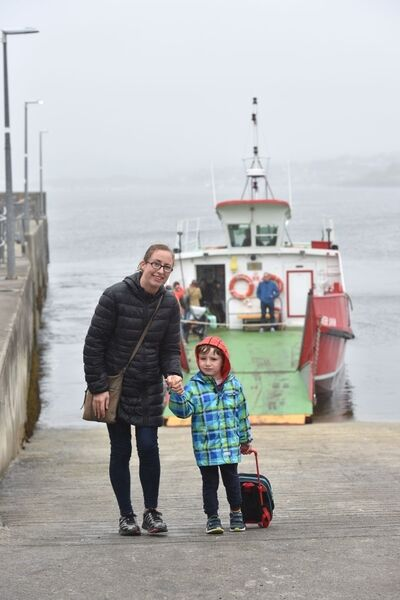 Olive O'Neill with William, 4, heading back to Sherkin Island on the ferry from Baltimore after picking him up from preschool.