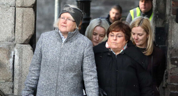 Annmarie Ryan from the Chief State Solicitor's office (second right, back) arriving at the public hearing at the Disclosures Tribunal in Dublin Castle. Photo: Leah Farrell/RollingNews.ie