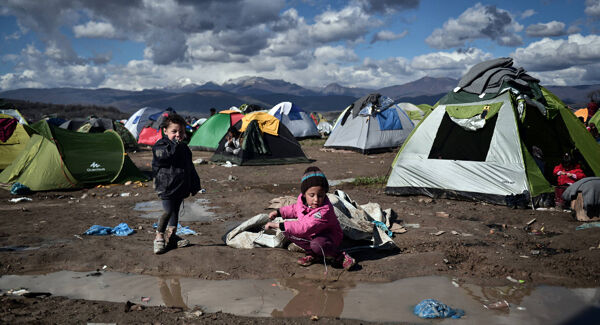 Children play at a makeshift camp near the Greek village of Idomeni in March 2016. Despite the strain on Greece, Prime Minister Alexis Tsipras has remained moderate. Picture: Louisa Gouliamaki