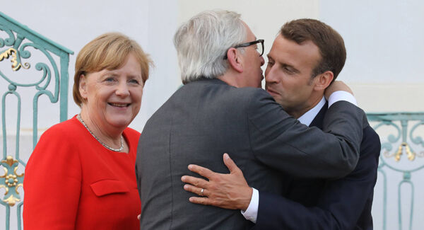 German chancellor Angela Merkel and French president Emmanuel Macron welcome EU Commission president Jean-Claude Juncker to the Meseberg Palace, northeastern Germany, ahead of a EU summit. Picture: Ludovic Marin