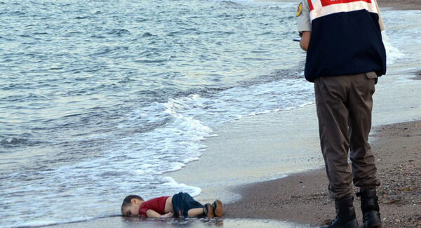 The iconic picture of the lifeless body of three-year-old Aylan Kurdi on the beach near the Turkish resort of Bodrum. In 2016, a court sentenced two Syrian smugglers to four years and two months each over the deaths of Aylan and four other people. Picture: Nilufer Demir