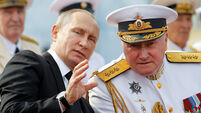 Russian President Vladimir Putin speaks with Commander-in-Chief of the Russian Navy Admiral Vladimir Korolev as they attend the