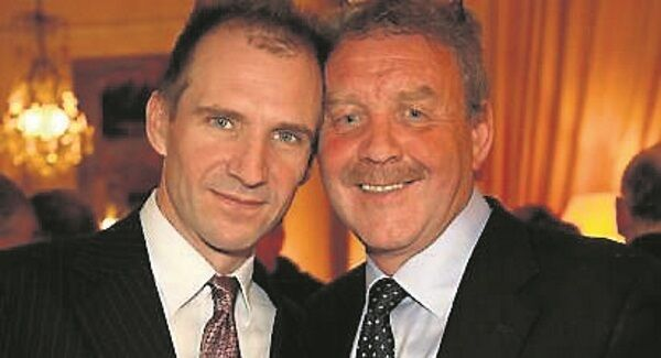 Michael Colgan with Ralph Fiennes at the French embassy in Dublin where Colgan received a Chevalier award for Arts & Letters. Picture: Anthony Woods