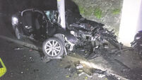 Men survive horror crash which saw car sliced by pole
