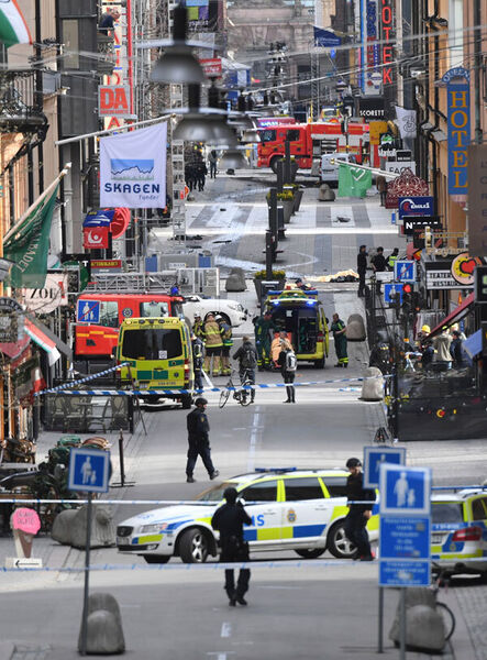 The scene on the pedestrianised street Drottninggatan in central Stockholm after a truck crashed into a department store killing four people and injuring 15 yesterday. Picture: Fredrik Sandberg/TT via AP