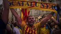 Catalonia and Northern Ireland: Battling over tribal past in a new world