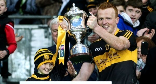 Amy lifts the trophy with Dr Crokes' captain Johnny Buckley. Picture: INPHO/Tommy Dickson