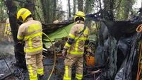 No injuries reported in fire at makeshift campsite near M50