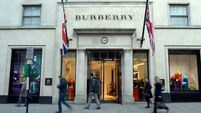 Burberry facing pay row gets sales boost from China