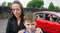 Mother and five children sleeping in car outside cemetery where husband is buried
