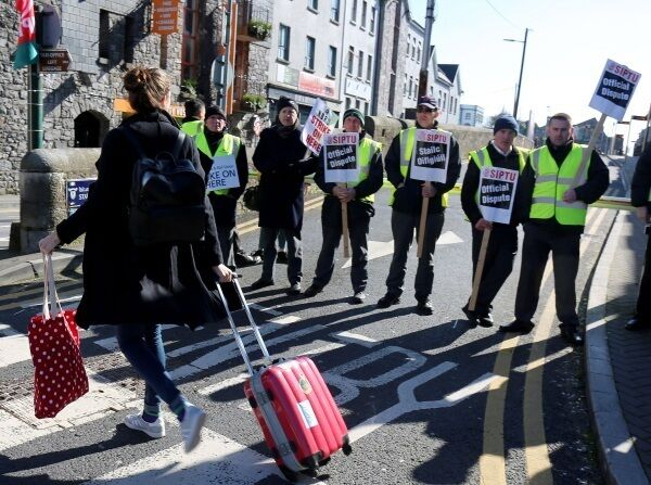 Passengers are left stranded outside Ceannt Station in Galway as Bus Éireann staff engage in an all-out strike yesterday.