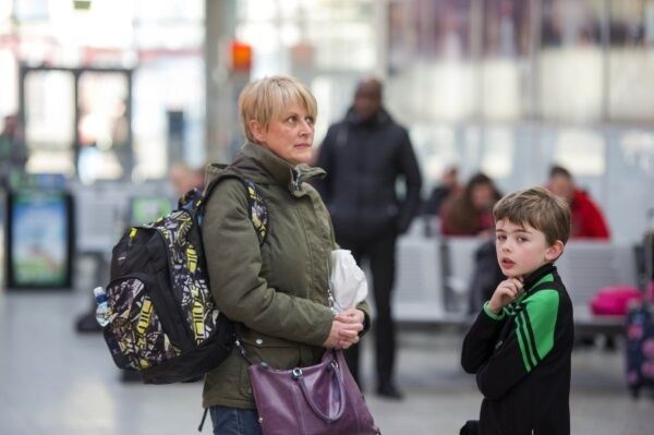 Claire O'Brien and son Conor wait at Cork's Kent Station to travel to the soccer in Dublin.