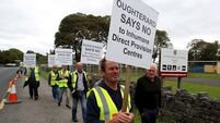 Justice Minister calls for direct provision centre protesters to 'step back'