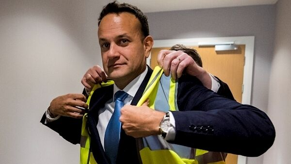 Taoiseach Leo Varadkar being helped to put on a high visibility jacket ahead of a factory visit to the shop floor of Combilift in Annahagh, Co. Monaghan after launching the Fine Gael's general election campaign. (Liam McBurney/PA Wire)
