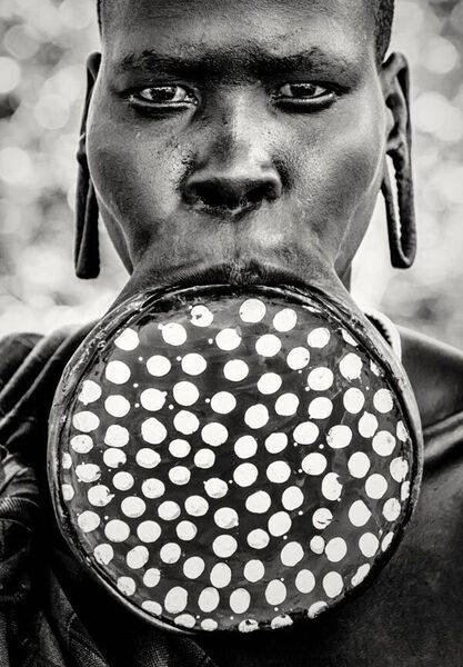 Mursi tribeswoman: 'The story goes that originally, the lip plates were put in to discourage slavers. But now it's become a custom and tradition — the size of the lip plate decides the dowry a girl will get when they get married. The Mursi are a pretty fearsome tribe in the Omo Valley in Ethiopia; all of the women carry Kalashnikov rifles. You would be walking along and you'd see a woman with a baby in one hand and a rifle in the other.'
